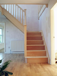 Quarter landing staircase in White fir hemlock with stop chamfered newel posts and balusters