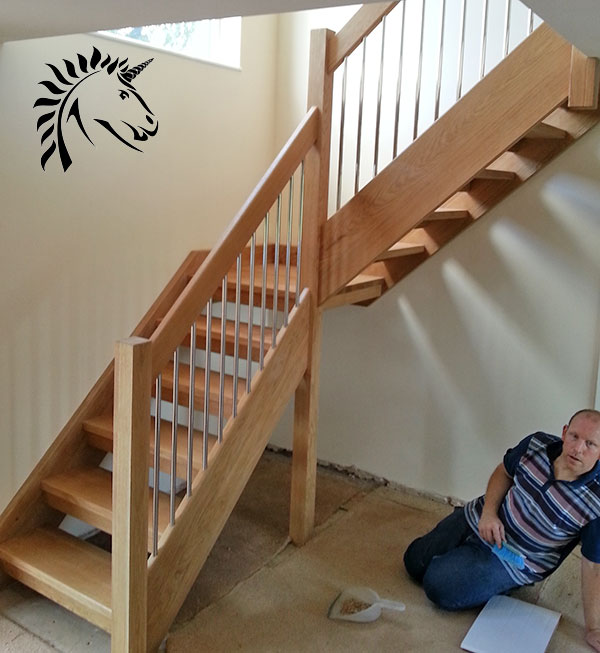 Oak staircase installed at broseley near telford stainless steel balusters