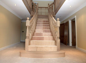 Prescott Flaired Staircase with wreathed handrails