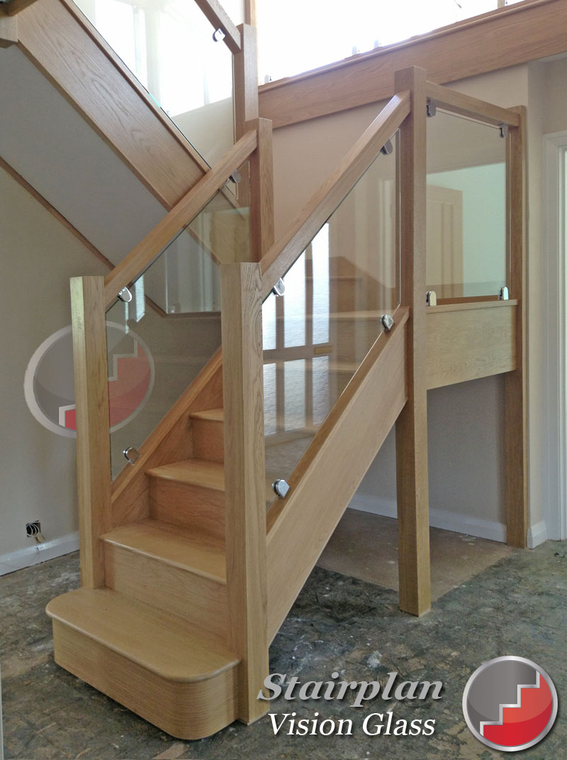 Oak Staircases with glass balustrade panels